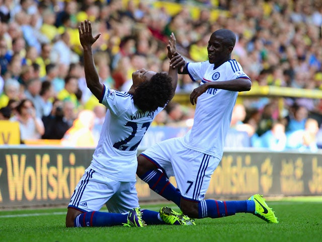 Willian of Chelsea celebrates scoring their third goal with Ramires of Chelsea during the Barclays Premier League match between Norwich City and Chelsea at Carrow Road on October 6, 2013