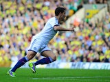Eden Hazard of Chelsea turns to celebrate after scoring their second goal during the Barclays Premier League match between Norwich City and Chelsea at Carrow Road on October 6, 2013