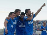 Pedro Leon of Getafe CF celebrates scoring their second goal with teammates during the La Liga against Real Betis on October 6, 2013