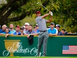 Tiger Woods of the U.S. Team watches his tee shot on the fourth hole during the Day Two Foursome Matches at the Muirfield Village Golf Club on October 4, 2013