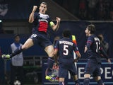 Paris Saint-Germain's Swedish forward Zlatan Ibrahimovic celebrates after scoring during a Group C Champions League football match between Benfica and Paris Saint Germain on October 2, 2013