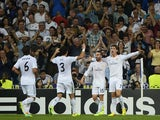 Real Madrid's Portuguese forward Cristiano Ronaldo celebrates with teammates after scoring during the UEFA Champions League Group B football match Real Madrid CF vs FC Copenhagen on October 2, 2013