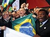 Brazil's President Luiz Inacio Lula da Silva (L), Rio 2016 bid President Carlos Arthur Nuzman (C) and Brazilian football legend Pele (R) celebrate the decision to award Rio de Janeiro the 2016 Olympic Games on October 2, 2009