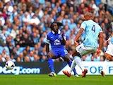 Everton's on-loan forward Romelu Lukaku scores against Manchester City on October 5, 2013