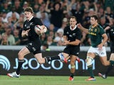 Beuden Barrett of the All Blacks breaks clear to score the bonus point winning fourth try during the Rugby Championship match between South Africa Springboks and the New Zealand All Blacks at Ellis Park on October 5, 2013