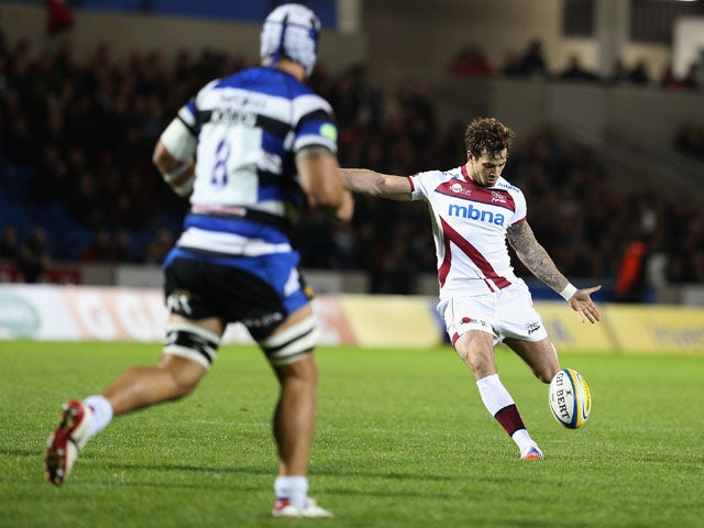 Danny Cipriani of Sale scores a drop goal watched by Leroy Houston of Bath during the Aviva Premiership match between Sale Sharks and Bath at the AJ Bell Stadium on October 4, 2013