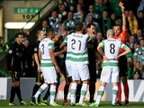 Celtic's Scott Brown is shown a straight red card in the second half against Barcelona during their Champions League group match on October 1, 2013