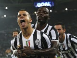 Sebastian Giovinco of Juventus celebrates his goal with Kwadwo Asamoah during the Serie A match against AC Milan at Juventus Arena on October 6, 2013