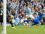 Manchester City's Sergio Aguero fires the ball past Tim Howard of Everton, during the game on October 5, 2013