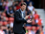 Michael Laudrup manager of Swansea City motivates his team during the Barclays Premier League match between Southampton and Swansea City at St Mary's Stadium on October 6, 2013