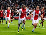 Ajax's Stefano Denswil celebrates after scoring the opening goal against AC Milan during their Champions League group match on October 1, 2013