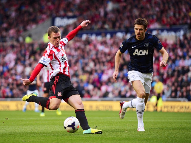 Craig Gardner of Sunderland scores the opening goal during the Barclays Premier League match between Sunderland and Manchester United at the Stadium of Light on October 5, 2013