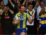Joel Monaghan of Warrington celebrates after scoring his team's first try during the Super League Grand Final between Warrington Wolves and Wigan Warriors at Old Trafford on October 5, 2013