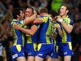 Ben Westwood of Warrington celebrates with teammates after scoring his team's third try during the Super League Grand Final between Warrington Wolves and Wigan Warriors at Old Trafford on October 5, 2013