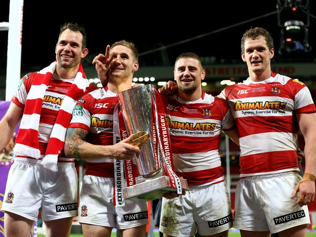 Pat Richards, Sam Tomkins, Michael McIlorum and Sean O'Loughlin of Wigan celebrate with the trophy following their team's 30-16 victory during the Super League Grand Final between Warrington Wolves and Wigan Warriors at Old Trafford on October 5, 2013
