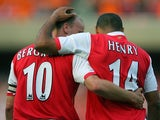 Thierry Henry and Dennis Bergkamp celebrate an Arsenal goal in July 2006.