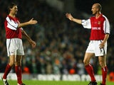 Steve Bould congratulates Tony Adams during his testimonial match in May 2002.