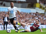Tottenham Hotspur's English midfielder Andros Townsend runs with the ball past West Ham United's English midfielder Kevin Nolan during the English Premier League football match between Tottenham Hotspur and West Ham United at White Hart Lane in London on