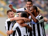 Danilo Larangeira of Udinese celebrates with team-mates after scoring his opening goal during the Serie A match between Udinese Calcio and Cagliari Calcio at Stadio Friuli on October 6, 2013