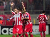 Olympiakos' Vladimir Weiss (C) celebrates with teammates after scoring a goal during the Champions League group C football match between Olympiakos and Paris Saint-Germain at the Karaiskaki stadium in Athens on September 17, 2013