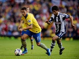 Mesut Oezil of Arsenal is chased by Claudio Yacob of West Bromwich Albion during the Barclays Premier League match between West Bromwich Albion and Arsenal at The Hawthorns on October 6, 2013