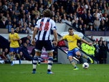 Jack Wilshere of Arsenal scores their first goal during the Barclays Premier League match between West Bromwich Albion and Arsenal at The Hawthorns on October 6, 2013