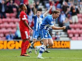 Grant Holt of Wigan Athletic celebrates after scoring his teams first goal and equaliser during the Sky Bet Championship match between Wigan Athletic and Blackburn Rovers at DW Stadium on October 6, 2013