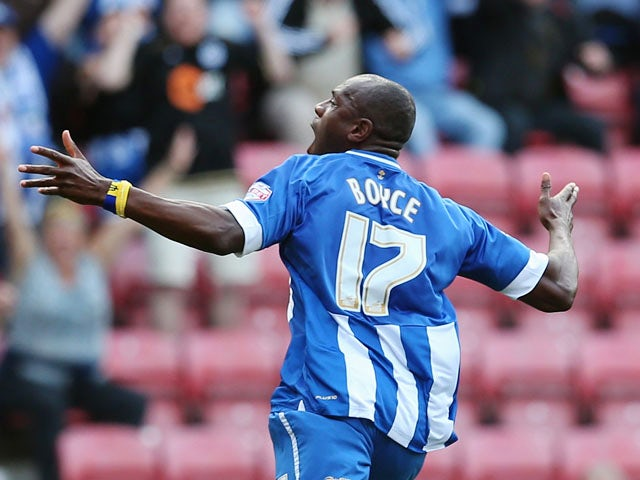 Emmerson Boyce celebrates after scoring the winning goal during the Sky Bet Championship match between Wigan Athletic and Blackburn Rovers at DW Stadium on October 6, 2013
