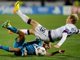 Zenit St Petersburg's Igor Smolnikov (L) vies with Austria Vienna's Daniel Royer (R) during their UEFA Champions League group G match on October 1, 2013