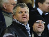 Television presenter Adrian Chiles looks on during the Barclays Premier League match between West Bromwich Albion and Wigan Athletic at The Hawthorns on December 10, 2011