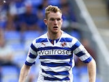 Alex Pearce of Reading in action during the Sky Bet Championship match between Reading and Ipswich Town at the Madejski Stadium on August 03, 2013