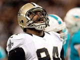 Cameron Jordan #94 of the New Orleans Saints celebrates a sack against the Miami Dolphins during a game at the Mercedes-Benz Superdome on September 30, 2013