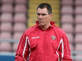 Sheffield United caretaker manager Chris Morgan looks on during the pre match warm up prior to the Sky Bet League One match against Coventry City on October 13, 2013
