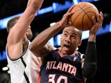 Atlanta Hawks' Dahntay Jones in action against Brooklyn Nets on March 17, 2013