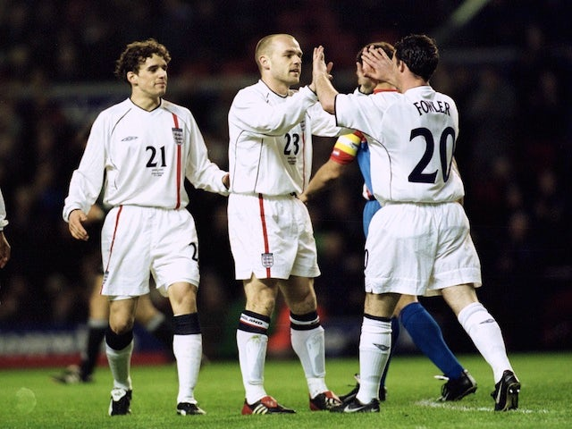 Danny Murphy of England celebrates scoring with his team mates during the Nationwide friendly match between England and Paraguay at Anfield on April 17, 2002