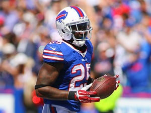Da'Norris Searcy #25 of the Buffalo Bills returns a fumble 74 yards for a touchdown against the New England Patriots at Ralph Wilson Stadium on September 8, 2013