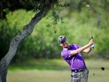 British golfer David Lynn plays a shot from the fairway to the ninth hole during third round of the Portugal Masters golf tournament at Victoria Golf Course in Vilamoura, southern Portugal, on October 12, 2013
