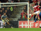 Nicklas Bendtner of Denmark scores his team's first goal past Italy goalkeeper Gianluigi Buffon to equalise during the FIFA 2014 world cup qualifier between Denmark and Italy on October 11, 2013
