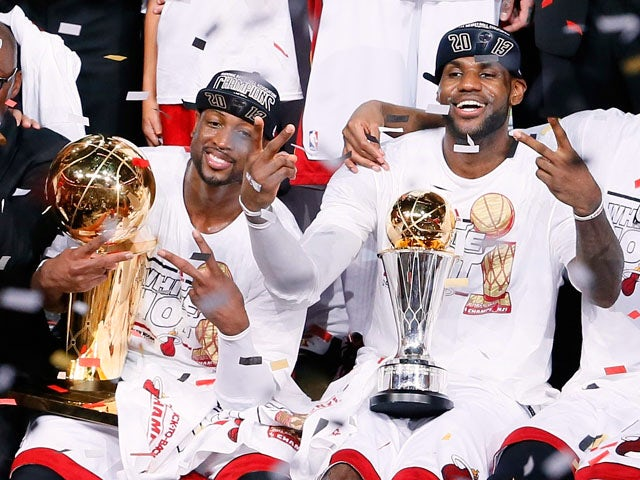 Dwyane Wade and LeBron James of the Miami Heat celebrate after defeating the San Antonio Spurs 95-88 to win Game Seven of the 2013 NBA Finals at AmericanAirlines Arena on June 20, 2013