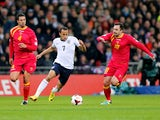 Andros Townsend of England takes on Nikola Drincic and Milan Jovanovic of Montenegro during the FIFA 2014 World Cup Qualifying Group H match between England and Montenegro at Wembley Stadium on October 11, 2013