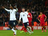 Daniel Sturridge of England celebrates with Wayne Rooney of England after scoring from penalty spot during the FIFA 2014 World Cup Qualifying Group H match between England and Montenegro at Wembley Stadium on October 11, 2013