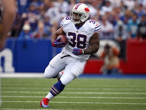 Frank Summers #38 of the Buffalo Bills carries the ball during NFL game action against the Carolina Panthers at Ralph Wilson Stadium on September 15, 2013