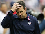 Head coach Gary Kubiak of the Houston Texans scratches his head as he leaves the field after being defeated 38-13 by the St. Louis Rams at Reliant Stadium on October 13, 2013