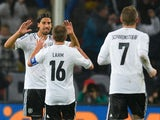 Germany's midfielder Sami Khedira celebrates scoring with Germany's defender Philipp Lahm during the FIFA 2014 World Cup Group C qualifying football match Germany vs Republic of Ireland in Cologne, western Germany on October 11, 2013