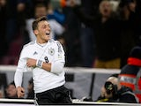 Germany's midfielder Mesut Ozil celebrates scoring his side's 3rd goal during the FIFA 2014 World Cup Group C qualifying football match Germany vs Republic of Ireland in Cologne, western Germany on October 11, 2013