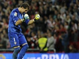 Athletic Bilbao's goalkeeper Gorka Iraizoz celebrates after his team scored during the Spanish league football match Athletic Club Bilbao vs Valencia CF at the San Mames stadium in Bilbao on October 6, 2013