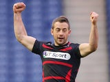 Edinburgh's captain Greig Laidlaw celebrates at the final whistle during the The Heineken Cup Pool 6 Match between Edinburgh and Munster at Murrayfield Stadium, on October 12, 2013