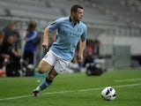 Harry Bunn of Manchester in action during a preseason friendly match between Manchester City and Al Hilal fight for the ball at Tivoli Neu on July 13, 2012