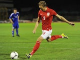 England U21 striker Harry Kane take a penalty during the 2015 UEFA European U21 Championships Qualifier against San Marino on October 10, 2013