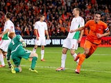 Robin van Persie of Holland celebrates after scoring their fifth goal during the FIFA 2014 World Cup Qualifing match between Holland and Hungary at Amsterdam Arena on October 11, 2013